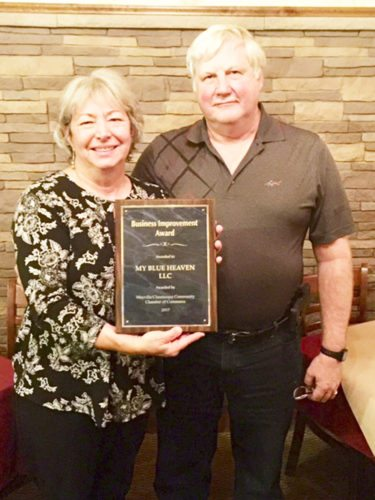 Submitted Photo  My Blue Heaven Inc. owners Jean and Mike Lobaugh are presented with the Business Improvement Award by the Mayville/Chautauqua Community Chamber of Commerce.