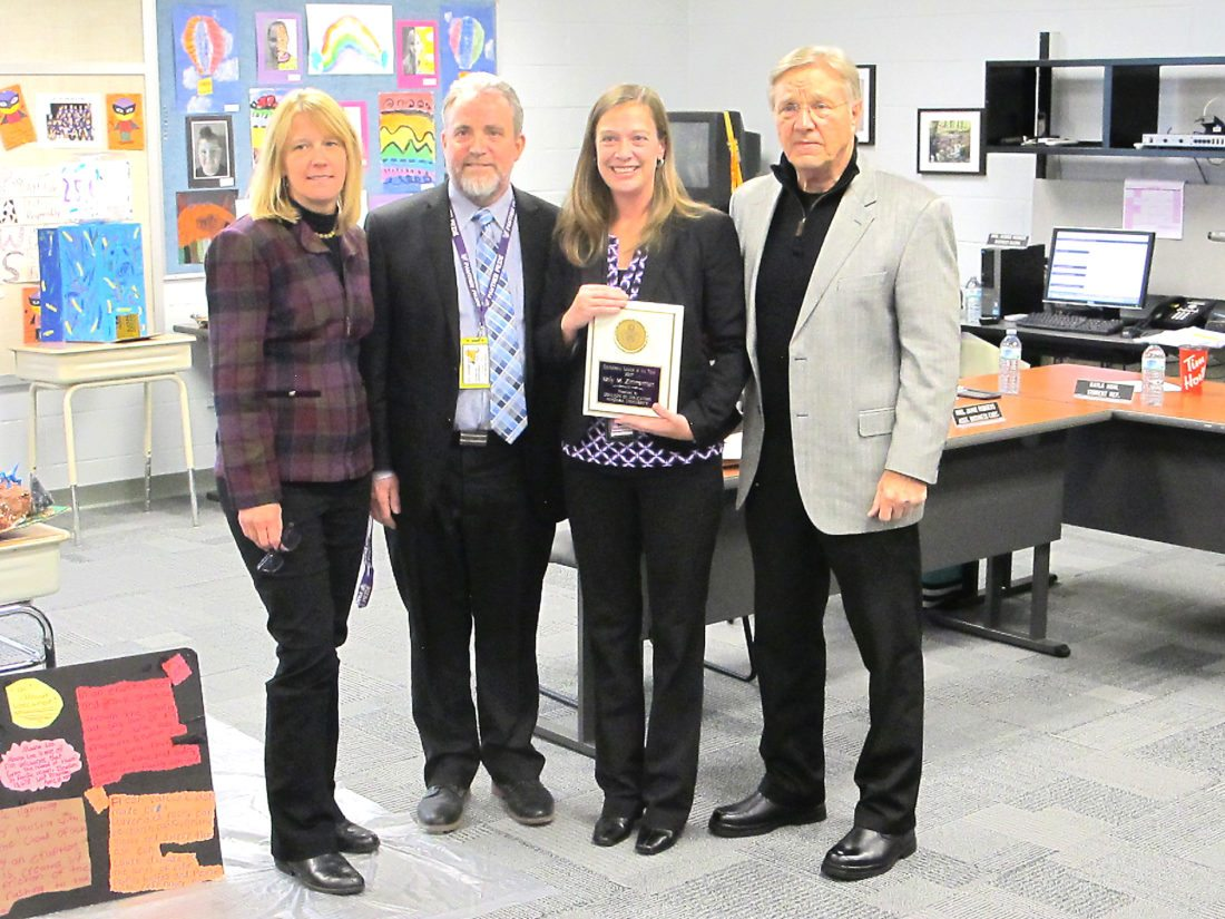 OBSERVERPhoto by Damian Sebouhian Kelly Zimmerman, Pine Valley elementary school principal holds her Educational Leader of the Year award bestowed by Niagara University's College of Education. Standing with Zimmerman are (from left to right) Chandra Foote, Dean of College Education at Niagara University; Scott Payne, Pine Valley superintendent of schools; and Dr. James Mills, supervisor of educational leadership at Niagara University.