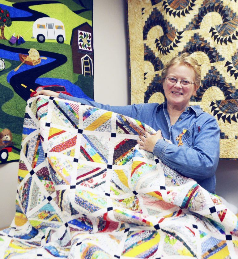 Submitted Photo Pictured is Deborah Kuczynski displaying one of her creations.