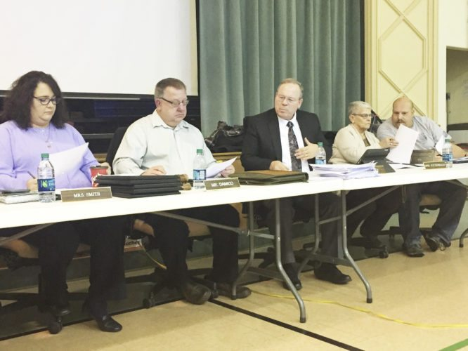 OBSERVER Photo by Jimmy McCarthy Dunkirk Schools' Superintendent Dr. James Tracy and Board President Dave Damico discuss the proposed reconfiguring at Thursday's meeting.