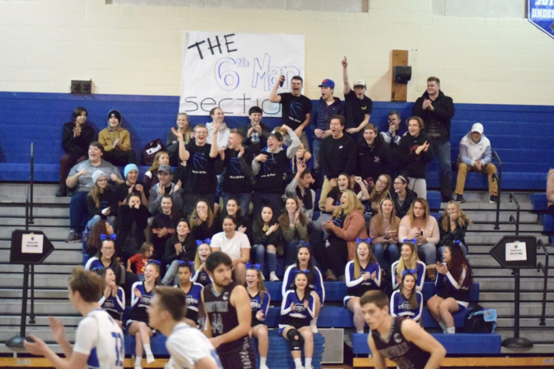OBSERVER Photo by Andrew David Kuczkowski Gowanda's Sixth Man student section stands and cheers Jan. 4 as the Panthers varsity boys basketball team plays Portville.