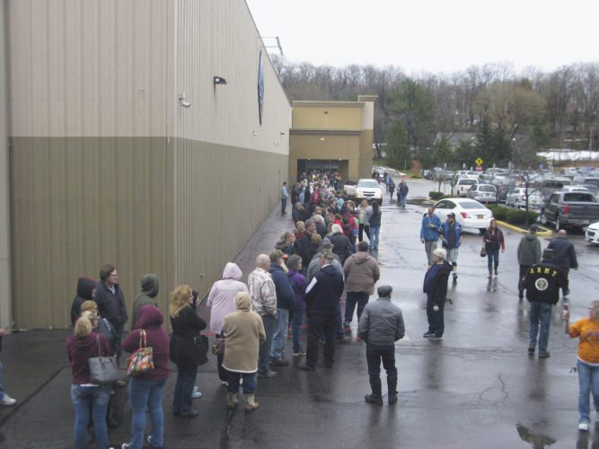 OBSERVERPhoto by Erie Tichy A line of customers wait to enter Sam's Club on Friday morning in the town of Ellicott, a day after the store announced it would close Jan. 26. Many said they were disappointed in the sudden announcement, but were looking for good deals, nonetheless.