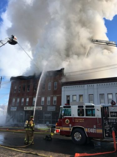 Photo by Gavin Paterniti: Smoke was seen for miles around billowing out of the Falconer Vac Shop building as fire personnel arrived on scene. The scene was eerily familiar because a fire broke out just two buildings away last year in March, taking down an entire section of Falconer's buildings.