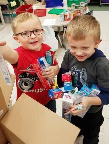 Submitted Photo  Brocton Elementary students pack boxes full of toiletries to help those still without power in Puerto Rico.