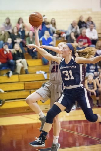 Photo by Valory Isaacson Southwestern's Carissa Minarovich (21) puts up a shot while defended by Chautauqua Lake's Alexis Jacobson Tuesday night.