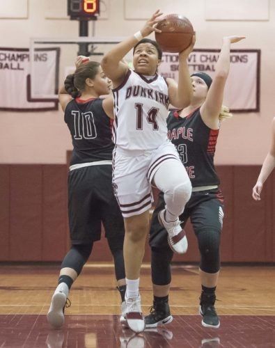 OBSERVER Photo by Ron Szot Dunkirk's Kymi Nance (40 cuts between Maple Grove's Lauren Grissom (10) and Bre Hill (23) during Tuesday night girls high school basketball action at Dunkirk High School. Dunkirk was defeated by the Dragons, 70-49.
