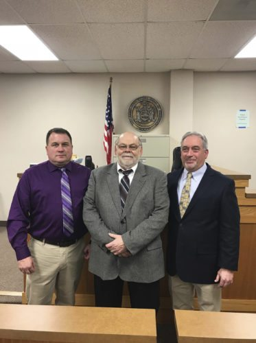 Submitted photo New Silver Creek village trustee Stephen Romanik was sworn in earlier this month, along with mayor elect Jeffrey Hornburg and re-elected trustee Warren Kelly.