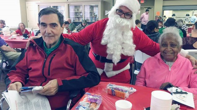 Submitted Photo Pictured at the Dunkirk Adult Day Care Center Christmas party are Roberto Denoya, Santa and Olga Velazquez.