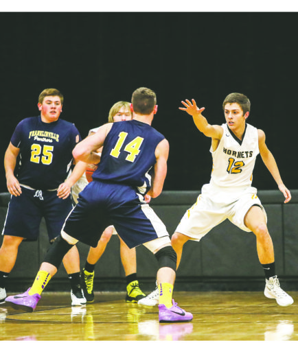 OBSERVER File Photo Forestville's Phil Narraway (12) defends during a regular-season basketball game.