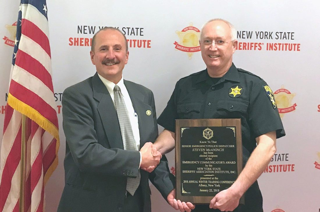 "Submitted Photo Steven McAninch, right, has been awarded the ""Emergency Communicator of the Year"" by the New York State Sheriffs' Institute. McAninch helped save the life of a woman who threatened suicide in July. He is pictured with Sheriff Joe Gerace."