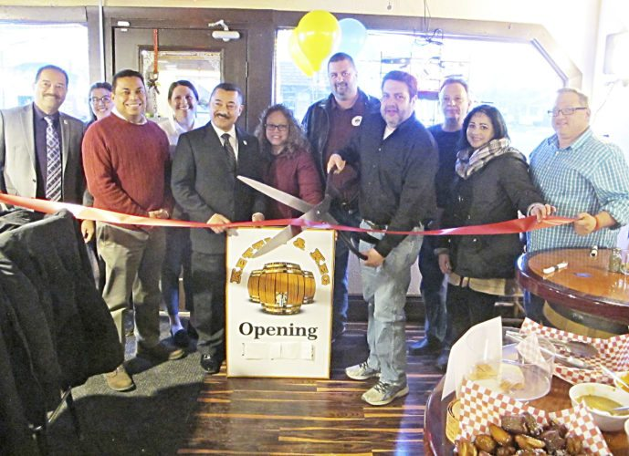 """Kettle & Keg owner Allen Steinberg was joined by Dunkirk Chamber of Commerce Director David Kelparek, Mayor Willie Rosas, Common Council members and the community Thursday for the official grand re-opening of the restaurant and bar located at 243 Lake Shore Drive E. Steinberg renovated the restaurant from kitchen to dining room, adding new menu items, a happy hour and seven flat-screen TVs. Steinberg thanked Rosas and his staff and the community for their support. Rosas said as the most active investor in the city, the development department has worked closely with Steinberg and more success stories are expected to come out of that department. Second Ward Councilman Marty Bamonto and Fourth Ward Councilman Mike Civiletto remembered """"The Keg"""" as a part of their past — for Civiletto as the neighbor to his father's Quality Bakery — and welcomed the community back to the city landmark."""