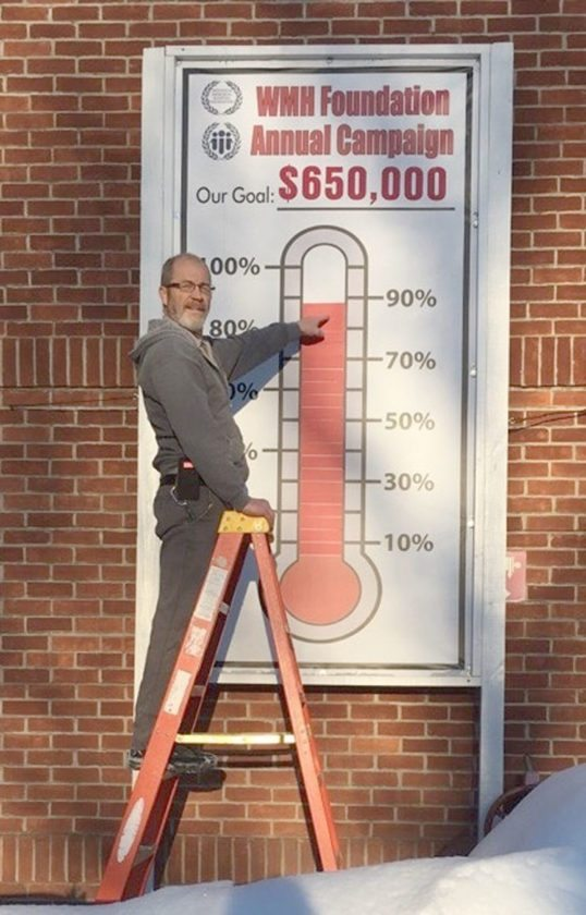 Submitted Photo Even with these frigid temperatures, Westfield Memorial Hospital Maintenance Lead Barry Wright is delighted to increase the thermometer to showcase the foundation's rising success.