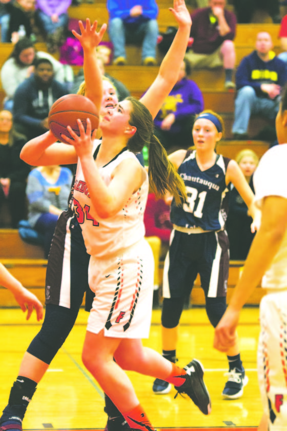 OBSERVER Photo by Mary Ann Wiberg Fredonia's Gracie Morrison attempts a layup during Thursday's Div. 1 West girls basketball game against Chautauqua Lake in Fredonia.