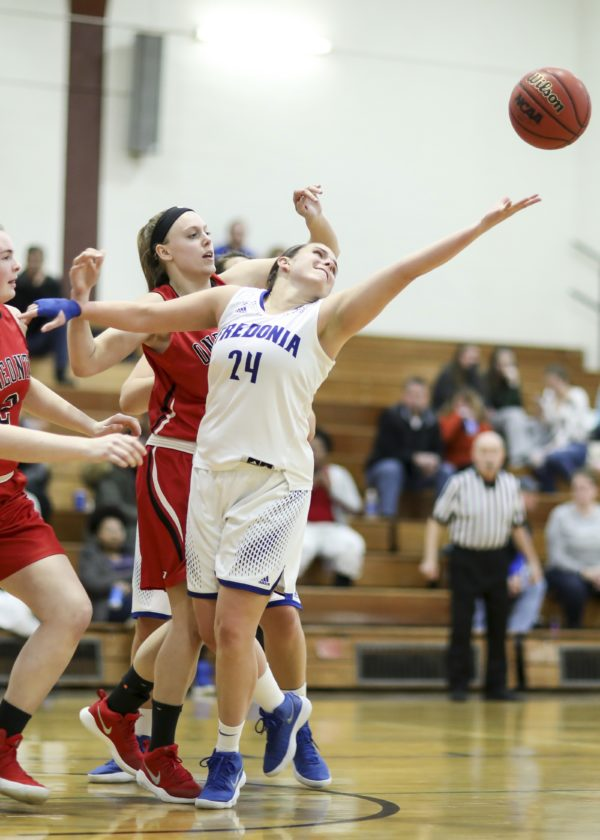 OBSERVER Photo by Joe Conti Fredonia's Emily Lasher and Oneonta's Casey Hayes battle for the ball Friday.