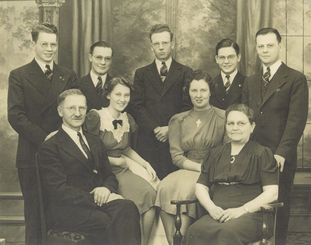 Photo courtesy of John Sipos, Cassadaga historian: The John Thomas Washington Jr. family of Dunkirk in 1938.  John Thomas Washington Jr. emigrated from England in 1898 to Dunkirk and married Mabel Eloise Pardee in 1907. He constructed his own home on West Sixth Street, where they raised their family. John Thomas was one of the oldest Dunkirk citizens when he died at the age of 103 years and 10 months in 1979.  He had been a chauffeur for Robert Gross of the Brooks Locomotive Company. Standing are children: George Washington, Orville Frank Washington, John Melville Washington (former mayor of Cassadaga), Albert Frederick Washington, and Edgar Thomas Washington.  Seated are John Thomas Washington Jr., Florence Kathryn Washington, Katherine Louise Kohlmeier Washington (wife of Edgar) and Mabel Eloise Pardee Washington. George married Genevive King, Orville married Esther Golubski, John married Lillian Fredrickson, Albert married Norma Faust, and Florence married Robert Kessler. One daughter Margaret Elizabeth Washington died at the age of 3.