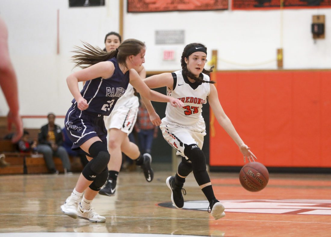 OBSERVER photo by Joe Conti Fredonia's Hannah Gullo dribbles while Abby McCoy of Franklinville pursues during a high school basketball game Saturday in Fredonia.