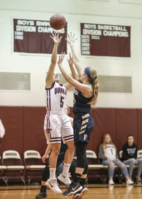 OBSERVER Photo by Joe Conti Dunkirk's Nadara O'Dell (5) shoots over Falconer's Sam Snow in Saturday's game.