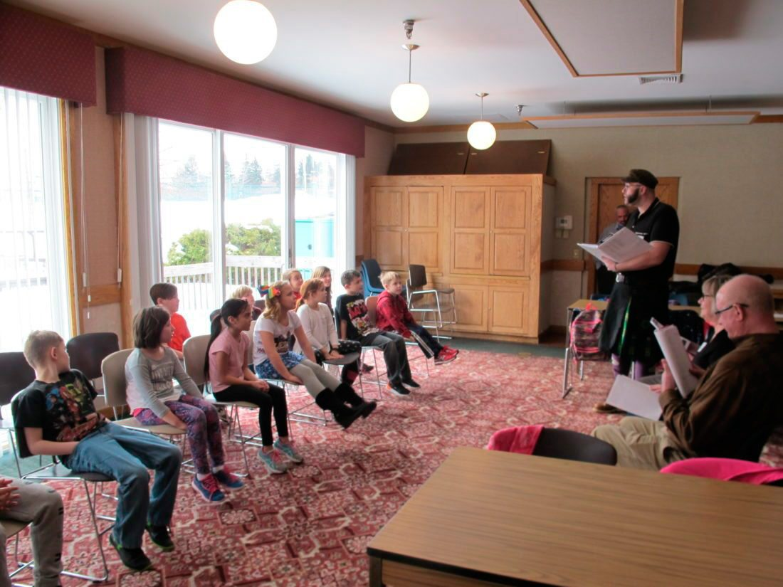 Photo by Gavin Paterniti Third-graders of Westfield Academy and Central School watch as their plays are read aloud by a team of Chautauqua Institution theater staff and volunteers led by Matt Cragan.