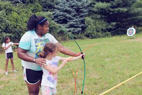 Submitted Photo Girls hitting the bullseye in archery at Camp Timbercrest.