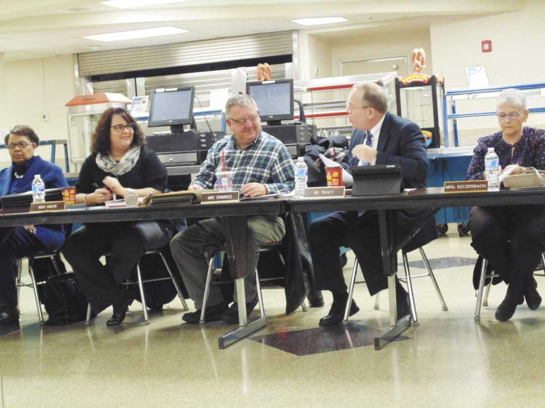 OBSERVER Photo by Jimmy McCarthy Dunkirk Schools' Superintendent Dr. James Tracy, far right, discusses school resource officer options with board of education members during Thursday's meeting at the middle school.