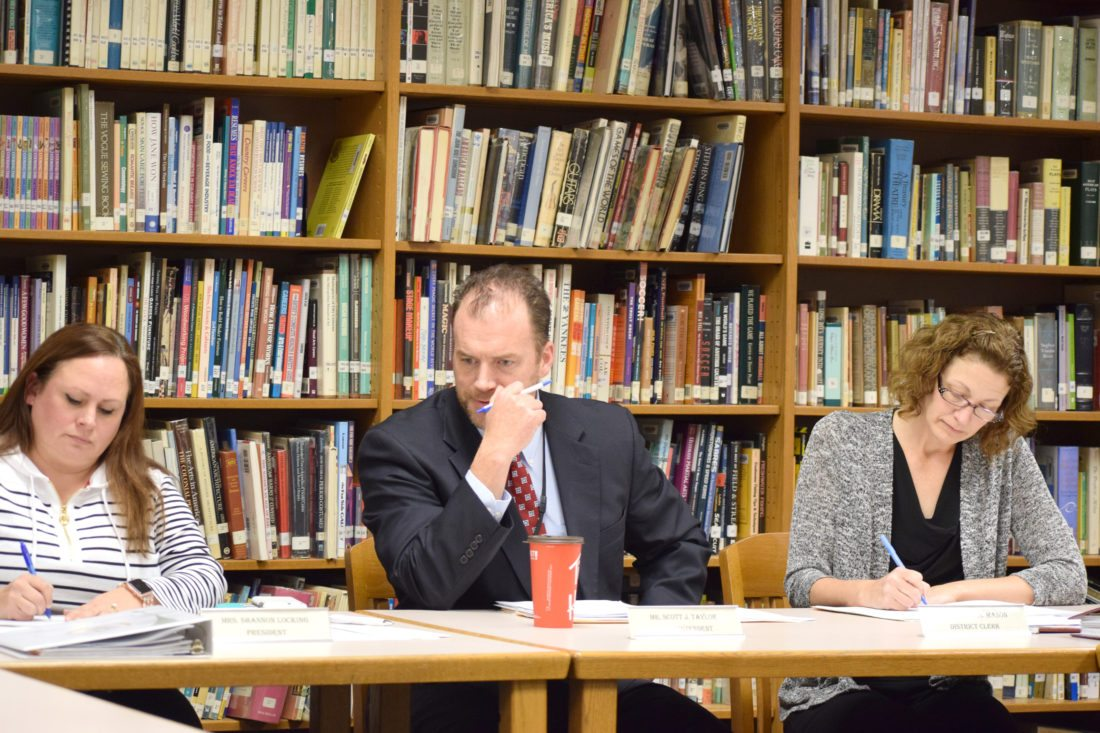 """OBSERVER Photo by Andrew David Kuczkowski North Collins Superintendent Scott Taylor, middle, said it was an """"individual decision"""" for those members to leave. Also in the picture are school board president Shannon McGrath-Locking, left, and district clerk Kathleen Mason."""