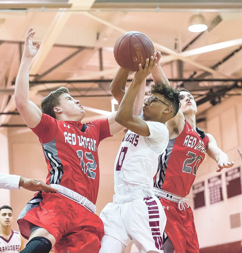 OBSERVER Photo by Ron Szot Andre Lockett puts up a heavily contested floater in Tuesday night's 69-66, win over Maple Grove.