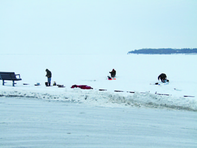OBSERVERPhoto by Gene Pauszek Ken Tarnowski, Mike Porpiglia and Ed Nalepa try their luck ice fishing out of Dunkirk on Sunday.