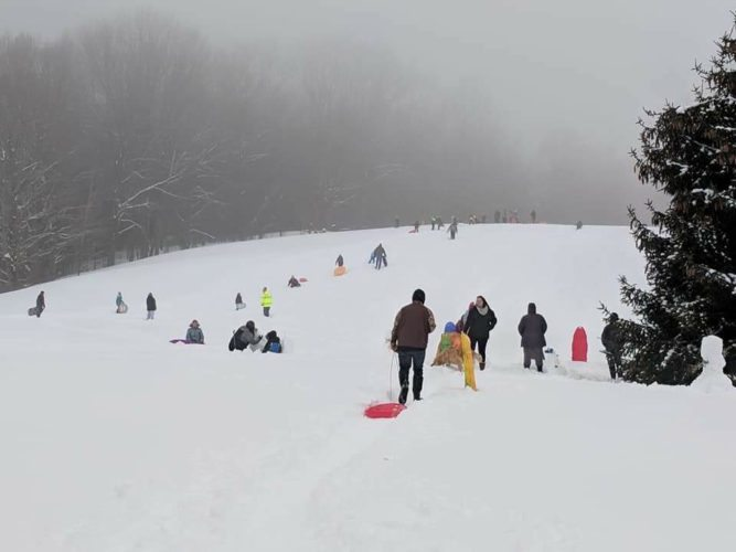Submitted Photo The Second Annual Cassadaga Winter Festival drew a large crowd this past weekend. One of the many activities included sledding which was organized by Boy Scout Troop No. 219.