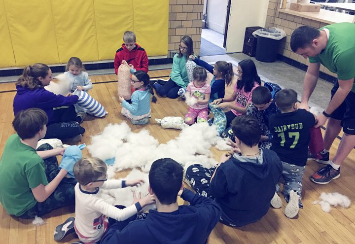 Submitted Photo NCCS students participate in a pillow-making event that memorialized deceased members of the Circle of Love. Pillows created by the children were donated to patients with cancer, through the Circle of Love.