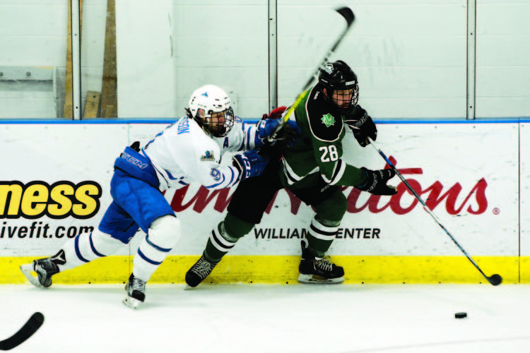 OBSERVER Photo by Justin Goetz Fredonia's Oskar Gerhardson (9) tries to check Morrisville's Dane Moore into the boards Friday during a SUNYAC hockey game at Steele Hall.