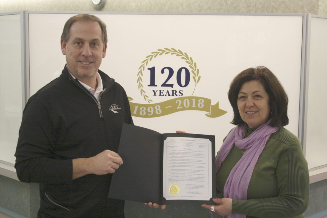 Submitted Photo Mark R. Maytum, President and COO of DFT Communication, receives a proclamation from Fredonia Mayor Athanasia Landis.