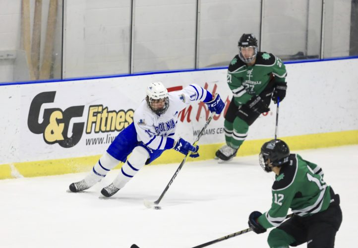 OBSERVER Photo by Joe Conti Fredonia's Sam Wilbur conrols the puck against Morrisville during Saturday night's game at Steele Hall.
