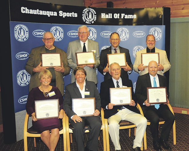 Photo by Scott Kindberg Chautauqua Sports Hall of Fame inductees, pictured in front, from left, are Sheilah Lingenfelter Gulas, Lori Franchina, Phil Young and Jim Riggs, representing his late father. In back, from left, are Clem Worosz, Dick Cole, Fran Sirianni and Curt Fischer.