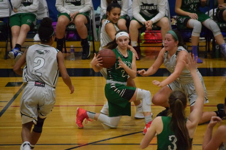 Lewiston-Porter's Anna Briganti, with ball on knee, looks for a teammate as she is covered by three Lady Eagle defenders.