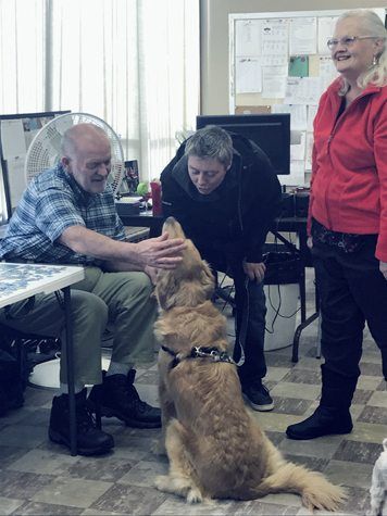 Submitted Photo The Chautauqua Adult Days Services provides  senior day programs for adults 60 years of age and older who live in the community. Pictured are Larry Feldt with the Hellman family and their dog, who are volunteers.