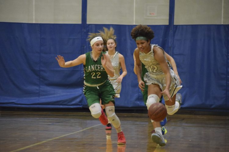 OBSERVER Photo by Andrew Kuczkowski Lake Shore's Shawni Cornfield, right with ball, dribbles up court with Lewiston-Porter's Claire Skowronski (22) keeping her to the sideline.