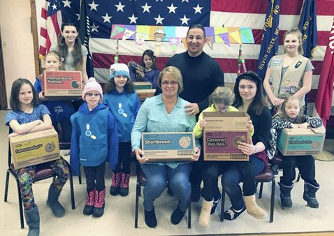 Submitted Photo In celebration of March for Meals 2017, members of Girl Scout Troop 20098 of Silver Creek delivered over 60 boxes of cookies to Meals on Wheels clients throughout the greater Silver Creek area. The cookies were purchased for distribution by Jim White's Truck and Auto Center.