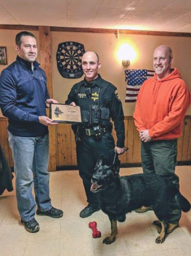 Submitted photo Deputy Jason Beichner of the Chautauqua County Sheriff's Office is pictured with K-9 Drago after the pair was recognized by the Jamestown Police Department Kendall Club. Drago recently had his front left leg amputated due to an infection.