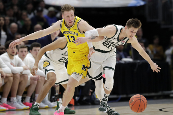 Late rush lifts Michigan State Spartans past Michigan Wolverinesfor Big 10 men's basketball title