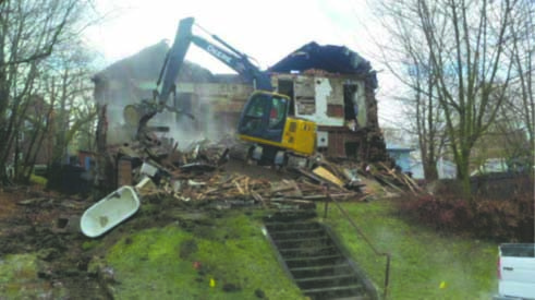 A house being demolished through work done by the Chautauqua County Land Bank Corporation. By the end of the year, the land bank, by working with community partners, will be responsible for more than 100 condemned houses in the county being demolished since 2012. Submitted photo