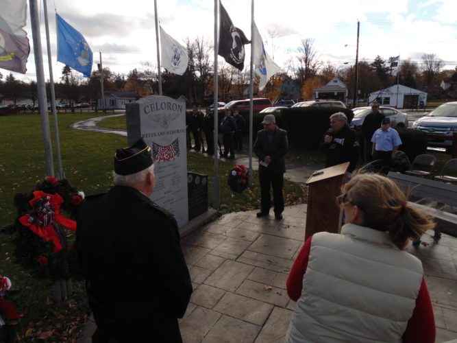 Local residents gathered at the Celoron Veterans Memorial at Lucille Memorial Park on Friday to remember the sacrifices of veterans. The names of local veterans who sacrificed their lives were read one-by-one during the ceremony.  P-J photo by Jimmy McCarthy