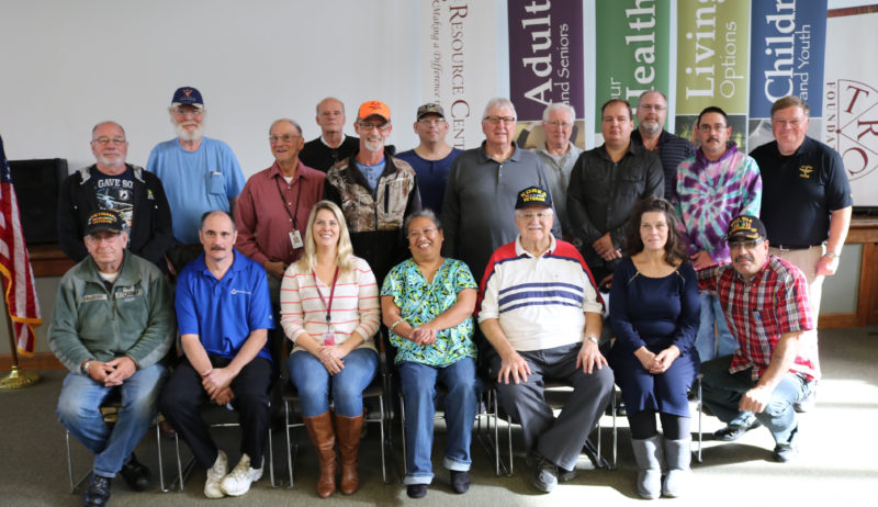 Some of the veterans who attended The Resource Center's Veterans Day event pose together. Submitted photo