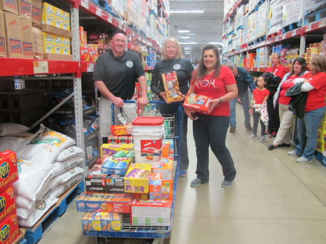 The Chautauqua County Sheriff's Office teamed up to help the Blue Star Mothers with their annual care package drive. The drive will continue through Nov. 30, and the finished packages will be sent to the troops overseas for the holidays. Pictured from left are Wes Johnson, vice-president of the Sheriff's union;Tina Holtz, union president; and Susan Crowley, Blue Star Mothers Lake Erie New York Chapter 4 president.