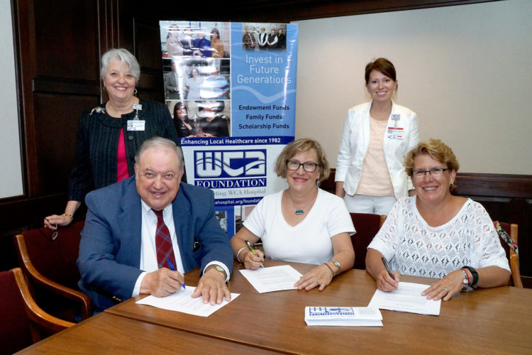 Pictured, sitting from left, are Kurt Pfaff, Susan Turnquist of Ashville and Hannah S. Szymczak of Fredonia, daughters of Shirley and Wilson Shaw, signing letters of agreement for the new Grateful Patient Fund in honor of Dr. Wilson Shaw. Standing from left, Brigetta Overcash, executive director of WCA Foundation, and Megan D'Angelo Barone, WCA Director of Development, worked with the two families to create a fund for all people to donate to in gratitude for those who supply their health care services. Submitted photo