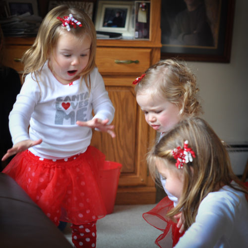 Delaney Walters is excited over something her cousin, Stella Smith, is playing with on the floor as Serena Smith looks on. Submitted photos
