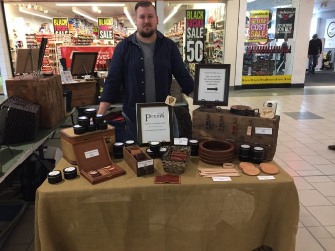Mason Premo, owner of The Premo Workshop, showcases his products at the Chautauqua Mall on Black Friday. Activity commenced yesterday at 6 a.m. as shoppers made their way to stores to find doorbusters and Black Friday deals — as much as 50 percent off an entire purchase. P-J photo by Jimmy McCarthy