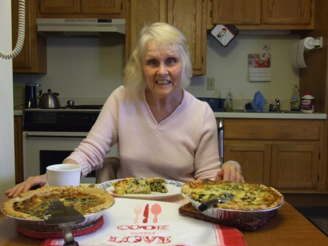 Cindy Lees likes to make and eat quiche. Here she displays Spinach Quiche and Crab Quiche.