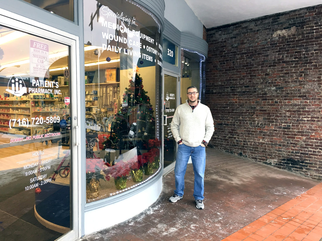 Tim Scoma, Patient's Pharmacy marketing representative, shows the brickwork and large storefront windows facing North Main Street at the downtown location. Scoma said renovations to the store were recently completed. P-J photo by Katrina Fuller