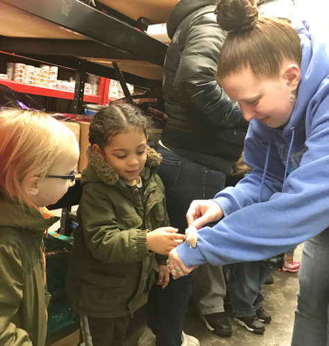 """Ashley Simon from Clearwater Aquarium and Pet Supply showed Love Elementary School 3-year-old UPK students different animals during a recent field trip to highlight their """"pet"""" unit."""