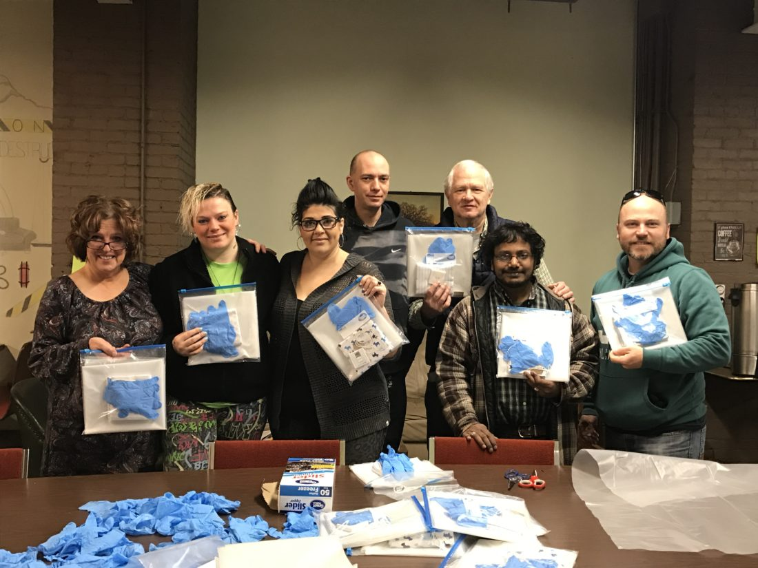 Members of both the United Christian Advocacy Network and the Mental Health Association gathered together Friday morning to create 50 birthing kits to send with missionaries to Haiti. Pictured from left are Jennifer Diamond, Amanda Penhollow, Samantha Sargent, Joshua Crist, Charlie Hodges, Joe Anderson and Benny Karlson.  P-J photo by Katrina Fuller